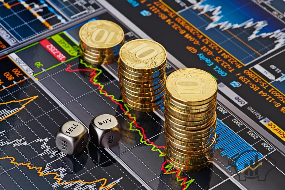 Dices cubes with the words SELL BUY, downtrend stacks of golden coins. Financial chart as background. Selective focus